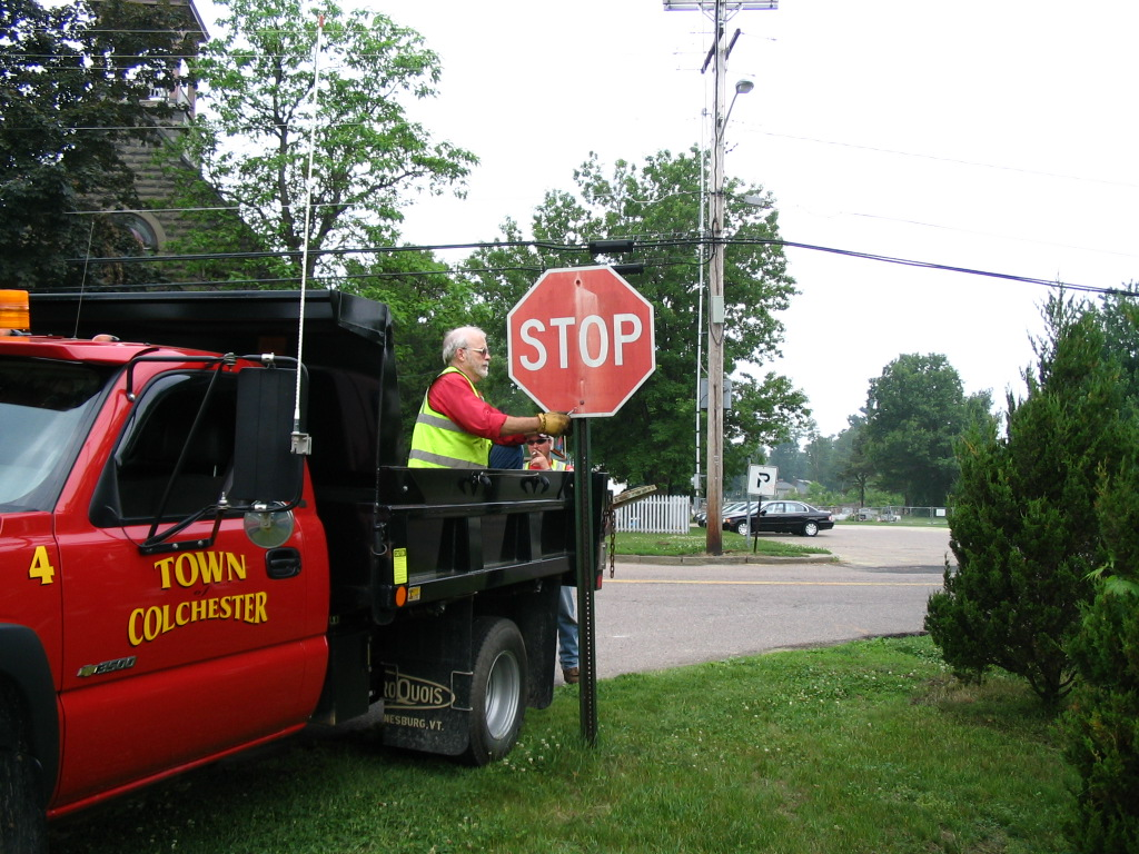 Working working on a stop sign