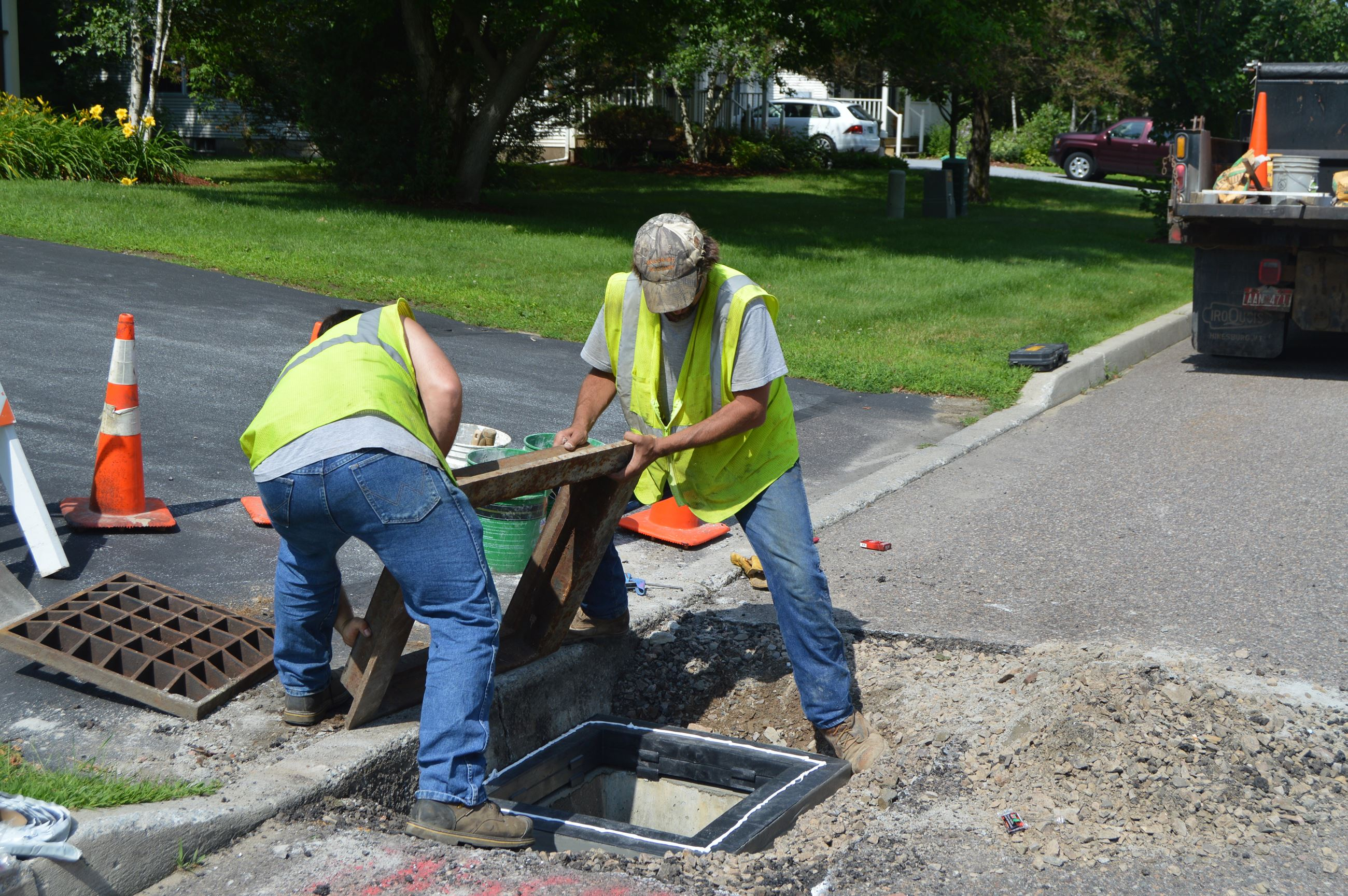 Town Employees performing repairs on a catch basin.