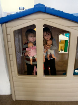 Children playing in a toy house