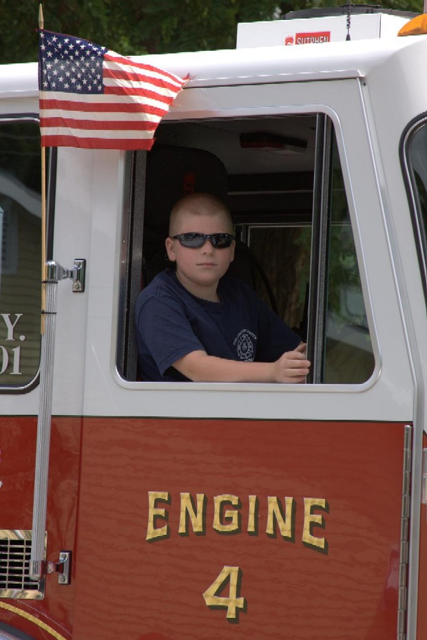 Cool shades on kid in fire truck